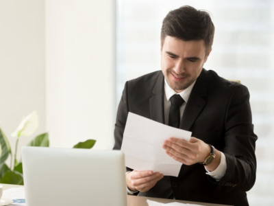 man holding a piece of paper