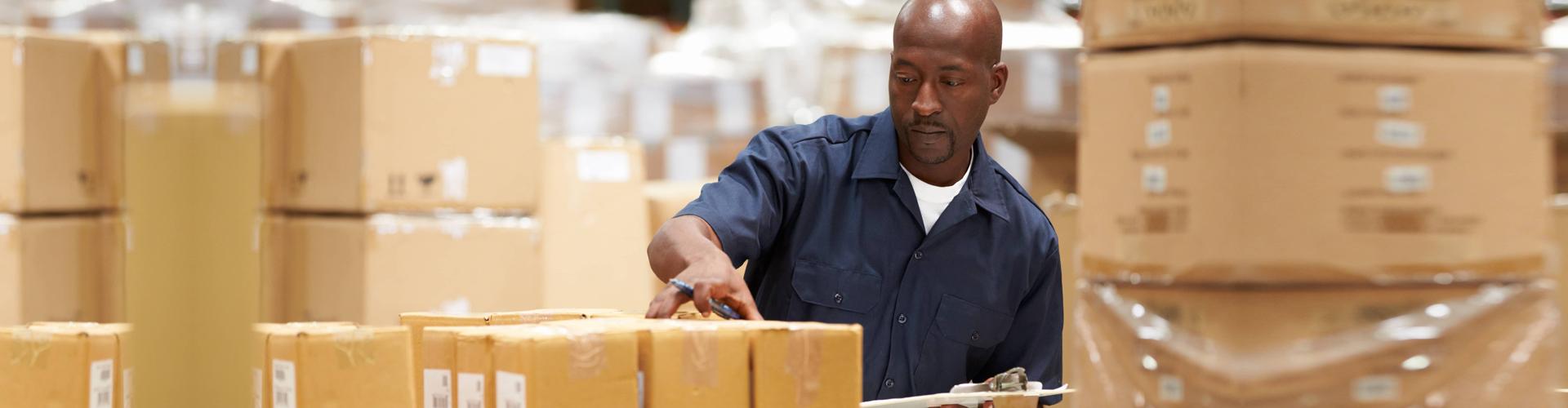 man sorting packages