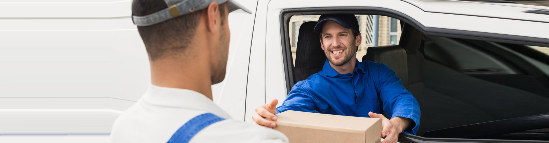 man handing parcel to another man